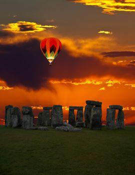 The famous Stonehenge in England on a sunrise background