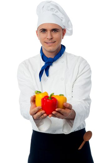 Chef showing fresh capsicums
