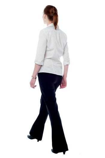 Business woman in walking posture