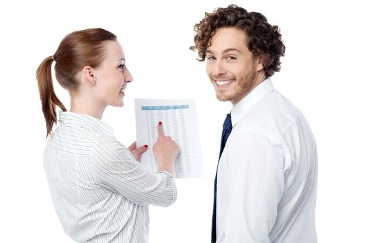 Lady pointing at statistics given on report