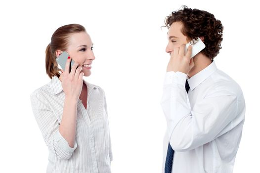 Office executives engaged over a phone call