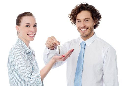 Businessman handing over the key