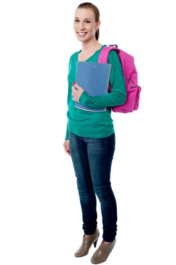 Young college girl posing with backpack