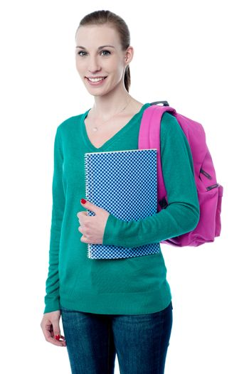 Young college girl with backpack and notebook