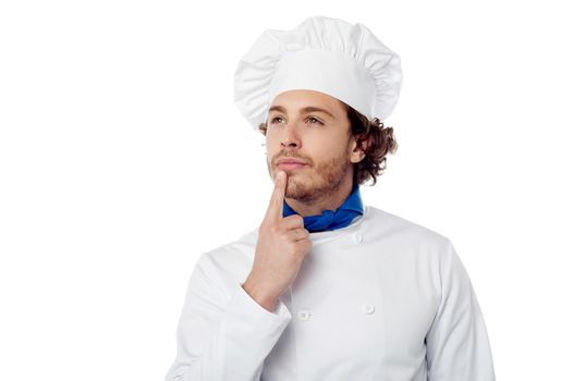 Male chef lost in deep thought