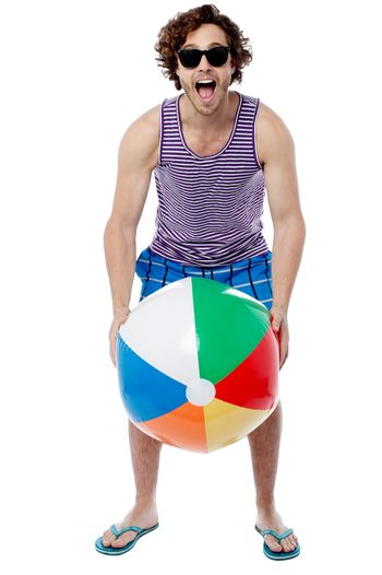 Cool guy playing with beach ball