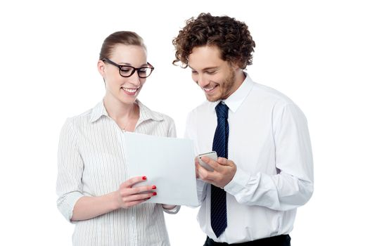 Colleagues reviewing business document