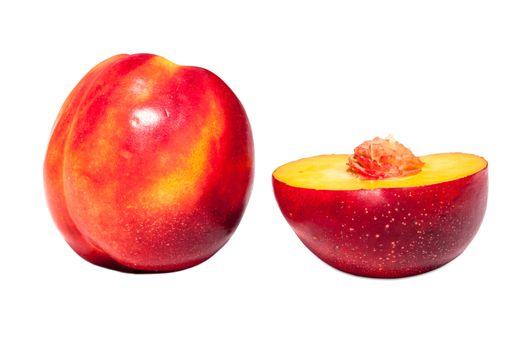 Fresh, juicy and tasty nectarine on white background.