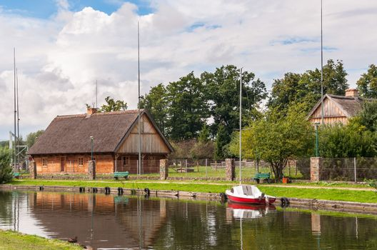 Old hause and boat at canal in Wegorzewo.