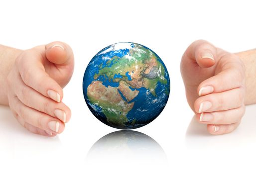 Hand of the person holds globe.