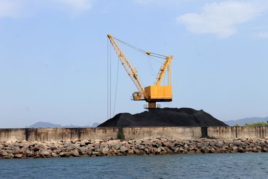 Crane and pile of coal on docks