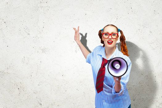 Funny looking woman speaking with a megaphone