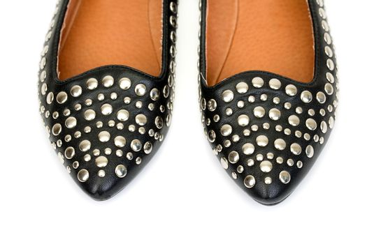 Black women's leather ballet flats with steel rivets close up