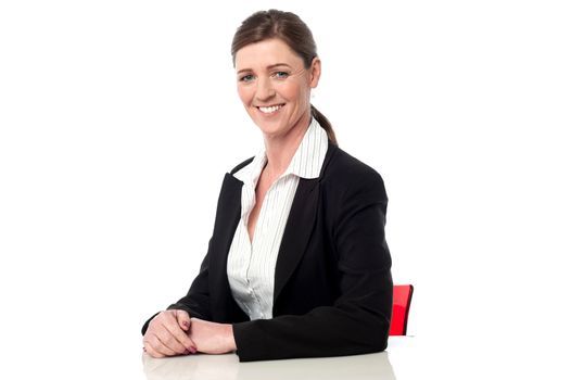 Relaxed smiling corporate woman