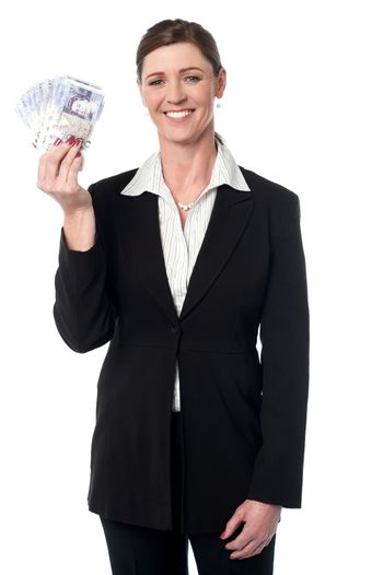 Corporate lady displaying fan of Pound Sterling