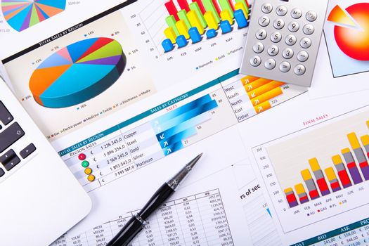 Financial paper charts and graphs on the table