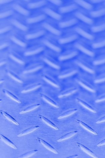 Seamless steel diamond plate texture in blue color