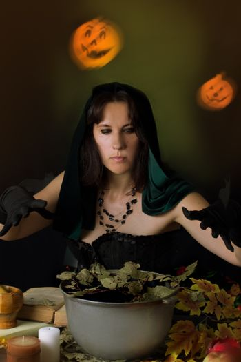 Witch practising sorcery at Halloween