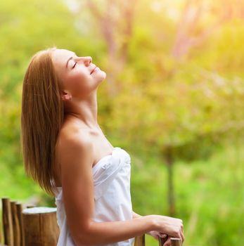 Calm woman on terrace