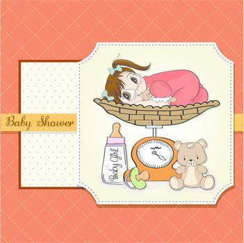 Beautiful baby girl on on weighing scale