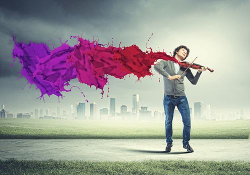 Young man violinist