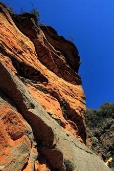 Awe inspiring red cliffs along the National Pass - Australia