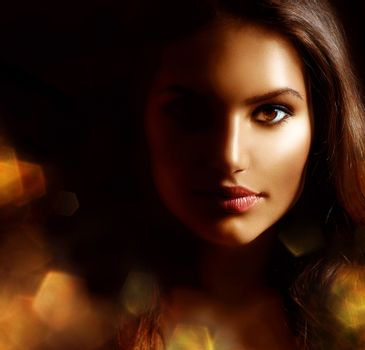 Beauty Girl Dark Portrait with Golden Sparks. Mysterious Woman