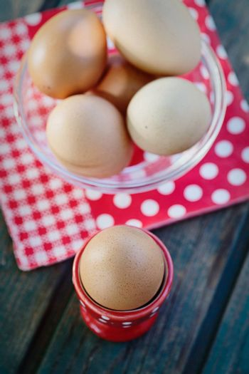 Healthy food- Breakfast with boiled eggs on wood.