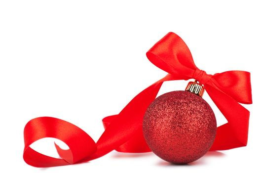 Red christmas ball with red bow over white background