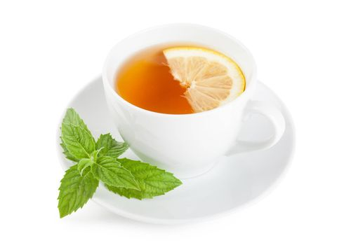 Tea with piece of lemon and mint on a plate over white background