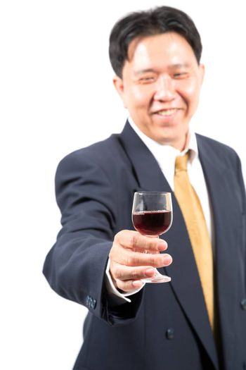 businessman with glass of wine (selective focus at glass)