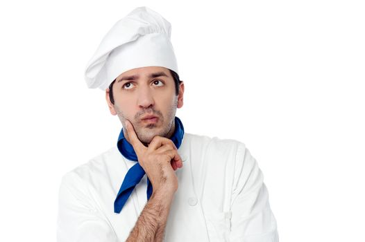 Male chef lost in deep thoughts