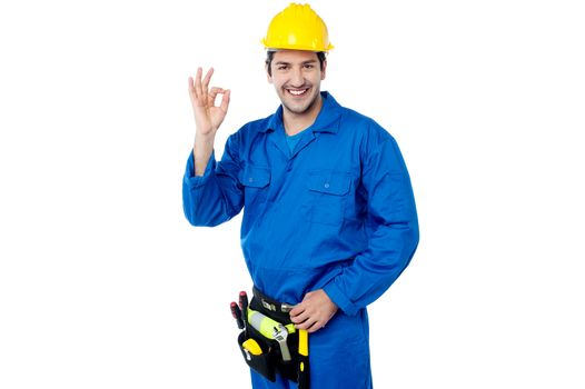 Construction guy gesturing okay sign