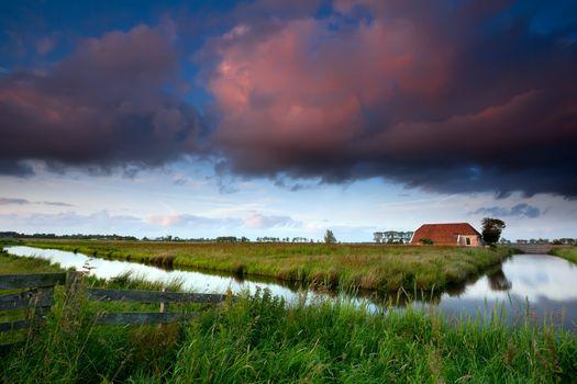 dramatic sunrise over Dutch farmland