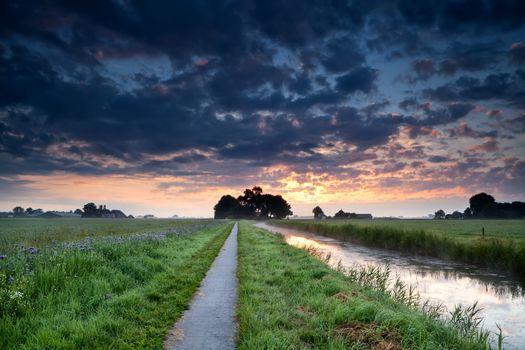 dramatic summer sunrise over farmland