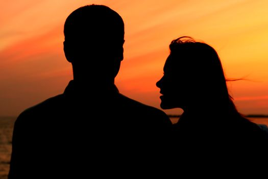 relax on gold sunset  romance flirt of two person on vacation