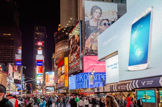 """NEW YORK - CIRCA MAY 2013: Times Square, New York, circa May 2013. Times Square is a major commercial intersection, iconified as """"The Crossroads of the World"""", it's the hub of the Broadway Theater District"""
