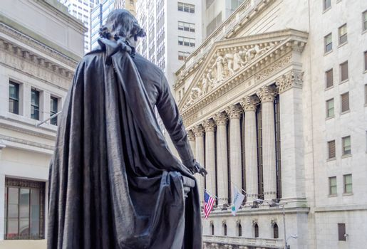 NEW YORK - MAY 27: The historic Wall Street facade from behind G.Washington statue in Federal Hall, May 27, 2013. Wall Street is the icon of global capitalism.