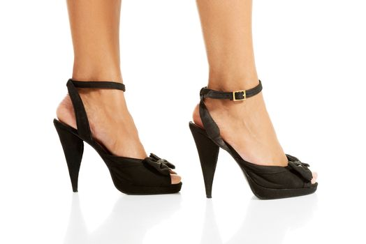 Woman's legs and high heel shoes