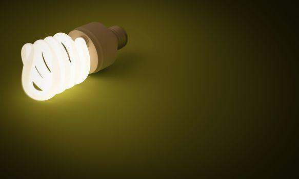 A lit spiral energy saving lightbulb on a green background.