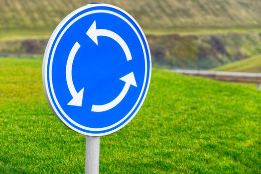 Circular junction road sign