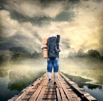 Tourist on the wooden bridge