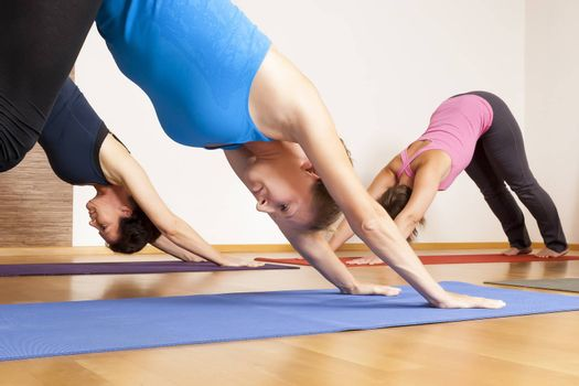 An image of some people doing yoga exercises