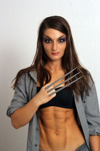 Sexy Brunette with Sharp Metal Claws