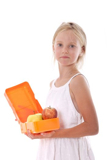 young girl with lunchbox containing apples