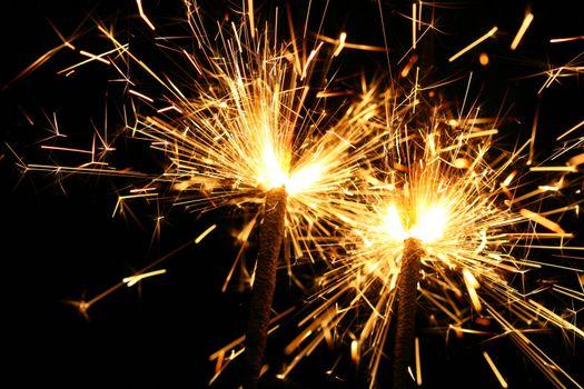 christmas celebration sparklers on black background