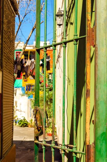 Green door leading to an old dilapidated patio in Buenos Aires