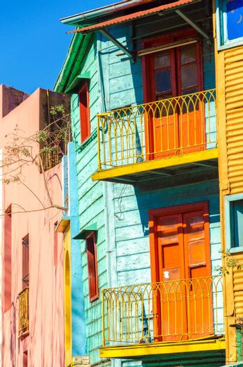 Brightly colored balconies on a dilapidated building in La Boca neighborhood of Buenos Aires