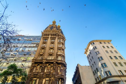 Old historic apartment building in San Telmo neighborhood of Buenos Aires, Argentina with birds flying above