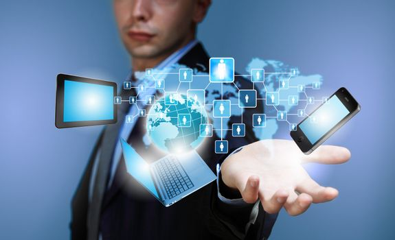 Image of business person holding devices in hands